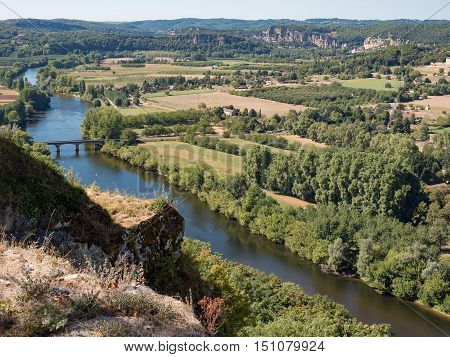 View of the river and the Dordogne valley with fields of crops and forests