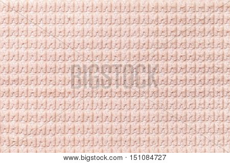Light coral background from soft fleecy fabric close up. Texture of textiles macro.