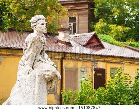 Sculpture of Gorky the writer in childhood standing in the courtyard of the house-museum in Nizhny Novgorod. Russia, Nizhny Novgorod. September 12, 2016
