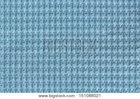 Light blue background from soft fleecy fabric close up. Texture of textiles macro.