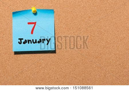 January 7th. Day 7 of month, Calendar on cork notice board. Winter time. Empty space for text.