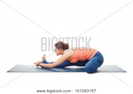 Woman doing Ashtanga Vinyasa Yoga asana Janu sirsasana B - head-to-knee pose B isolated on white background