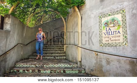 SAN ANTONIO, TEXAS - APRIL 14: An unidentified woman walks down the steps in the tourist area of La Villita in downtown San Antonio, Texas on April 14th, 2016.
