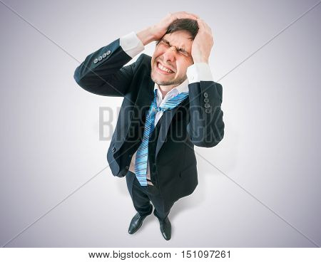 Disappointed Businessman Holds His Head. View From Top.
