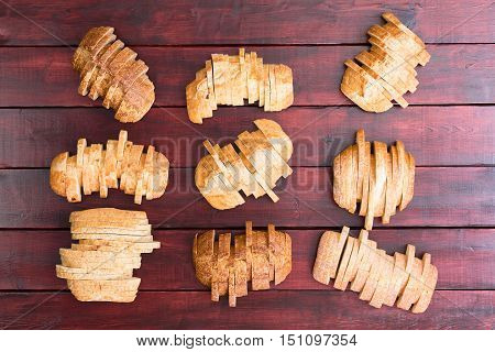 Nine Loaves Of Bread Sliced In Staggered Formation
