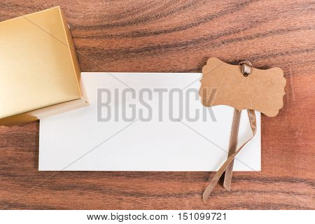 The white letter and a gold paper box on the wood background