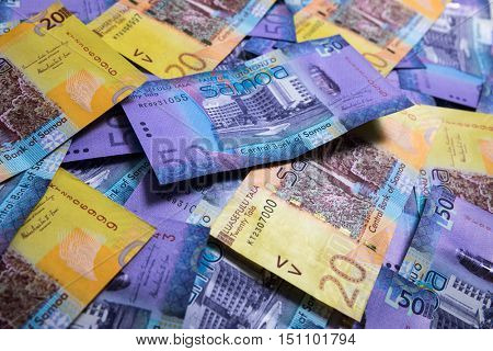 Samoa Tala bank notes on a table