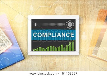 compliance word on tablet with soft light vintage effect