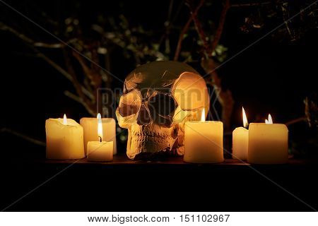 Abstract scary Halloween background with skull and candles