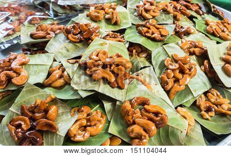 Sweet cashew nuts on leaf for sale.