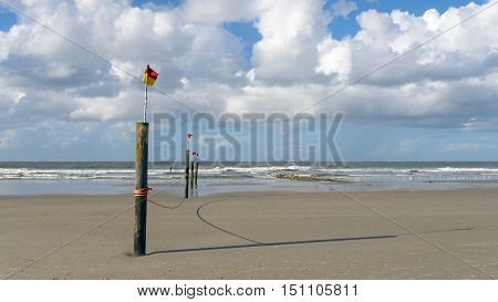 Flags Fluttering On Poles On A Tropical Beach