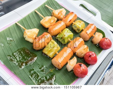 Grilled sausage and vegetable on the plate.