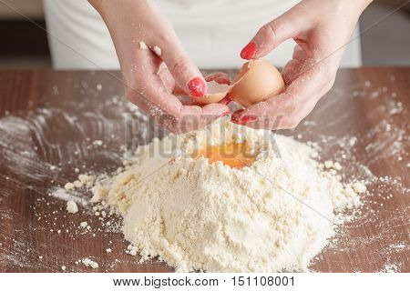 Making Pastry Dough For Hungarian Cake. Series. A Baker Mixing Flour, Sour Cream And Eggs