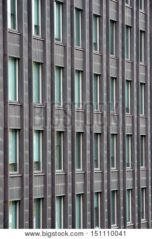 Exterior wall with many windows of multi-storey building.