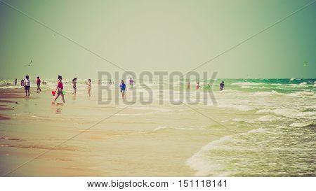 SOUTH PADRE ISLAND, TEXAS - APRIL 25: Beachgoers enjoying a Gulf of Mexico beach on South Padre Island on April 25th, 2016.