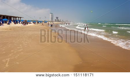 SOUTH PADRE ISLAND, TEXAS - APRIL 25: Beachgoers enjoying the beach at Blanca County Park on South Padre Island on April 25th, 2016.