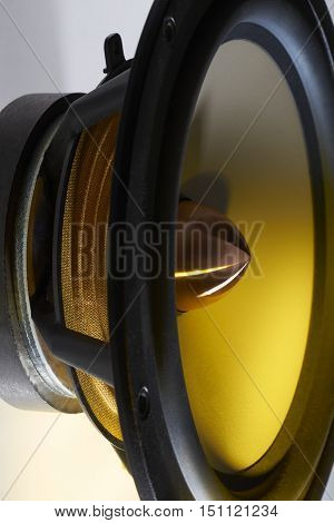 picture of a yellow illuminated loudspeaker detail