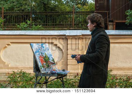 PETERSBURG, RUSSIA-  September 24: Student artist draws building naval school named after Admiral Makarov 24 September 2014 in Saint-petersburg.