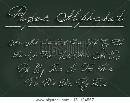 Florid cursive Latin alphabet of paper with white letters on a school chalk Board