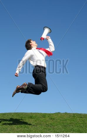 Businessman Jumping With Megaphone