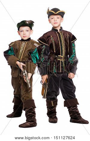 Two young boys posing in suits of medieval hunters. Isolated on white