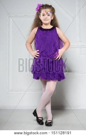 Young Girl Posing In Purple Dress