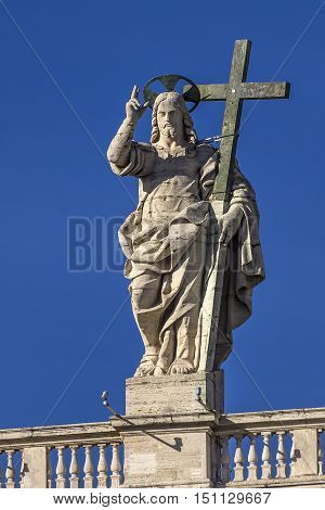 View of the statue of Christ the Redeemer on the balustrade of the baisilica of St. Peter in Rome