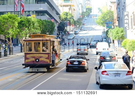 SAN FRANCISCO - MAR. 15, 2014: Antique Cable Car on California Street in downtown San Francisco, California, USA.