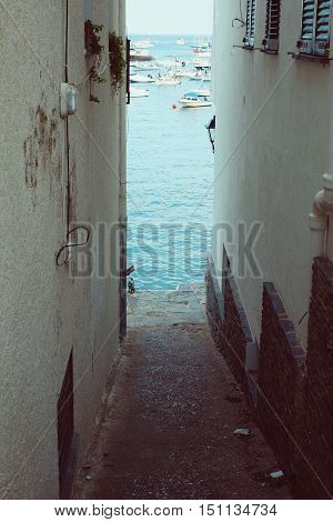 Alley street in Cadaques on Mediterranean seaside, Costa Brava, Catalonia, Spain
