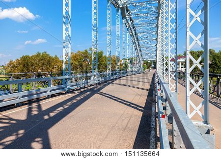 First in Russia steel arch bridge on river Msta. Historical iron bridge. Was build in 1905