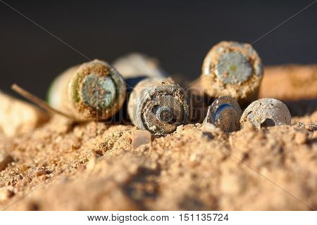 Exhaust alkaline batteries improperly thrown away not recycled and are poisoning the land.