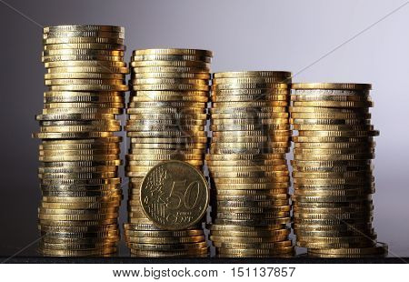 Four coin piles with 50 cent coin