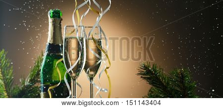 Champagne glasses decorated ribbons. Merry Christmas and happy new year