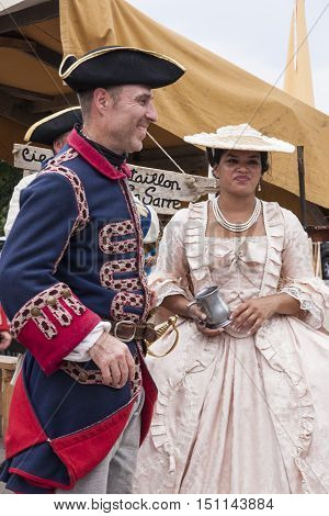 MONTREAL QUEBEC - AUGUST 28 2016: A couple dressed in 17th century clothing pose as a soldier and a noblewoman in Montreal