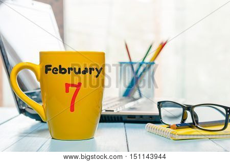 February 7th. Day 7 of month, calendar on CEO workplace background. Winter time. Empty space for text.