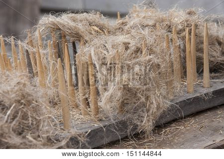 An old traditional tool to process flax fibers