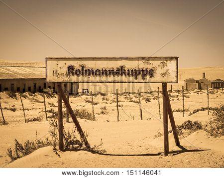 Kolmanskuppe, aka Kolmanskop, train station sign. Notice of old ghost diamond mining town of Kolmanskop near Luderitz in souther Namibia, Africa