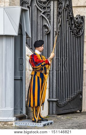 Rome Italy - July 12 2014: Swiss Guard at the entrance of the Vatican City in defense of the pope. Vatican City Rome Italy