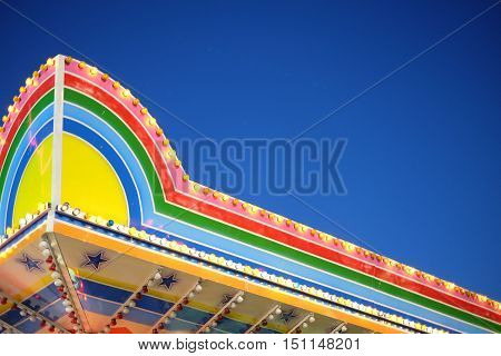 Amusement Park Ride in vibrant colors in blue poster