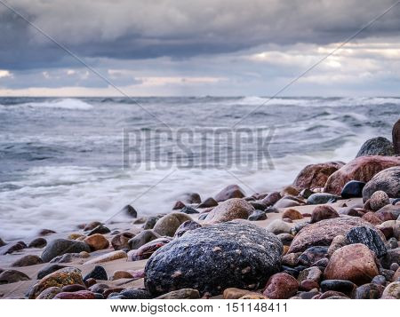 Rocky seashore with stormy sea waves