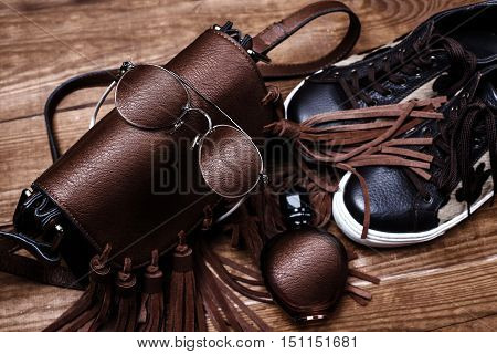 leather accessories. Shoes bag sunglasses and perfume