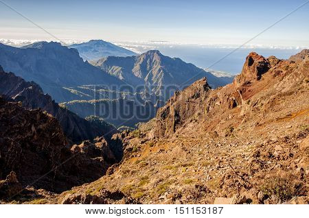 Picturesque scene of rocky mountains clear sky and sea in sunlight.