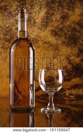 White wine with glass against colorful background