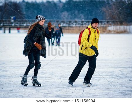 Girl And Fellow Ice Skating In Trakai