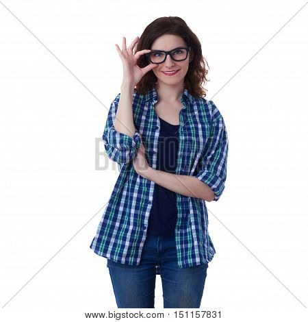 Smiling young woman in casual clothes and glasses over white isolated background correcting touching her glasses, happy people concept