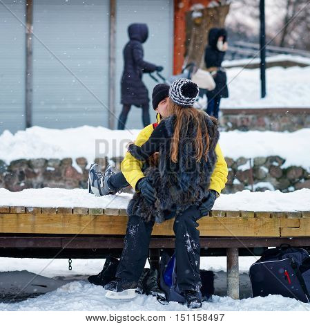 Young Fellow And Girl Kissing At Winter Rink In Trakai