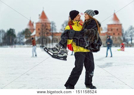 Young Girl And Fellow At Rink In Trakai