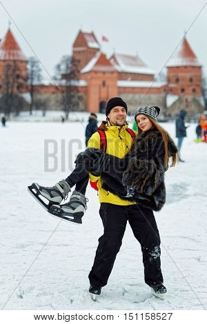 Young Girl And Fellow At Rink In Trakai In Lithuania