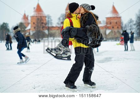 Young Girl And Fellow Kissing At The Rink In Trakai