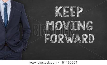 Businessman Writing Keep Moving Forward Writing on Chalkboard